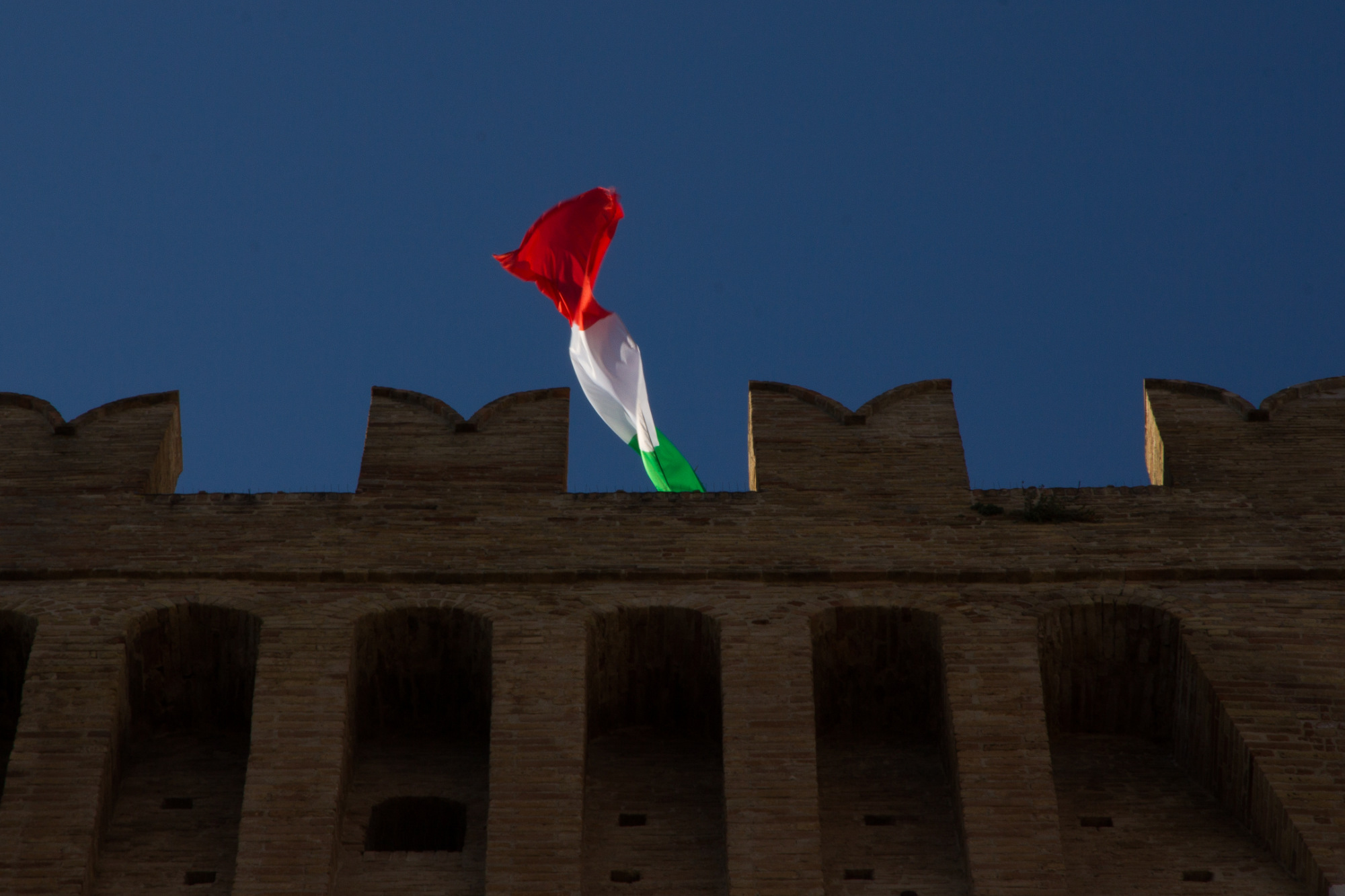 recanati italian flag flies above city tower